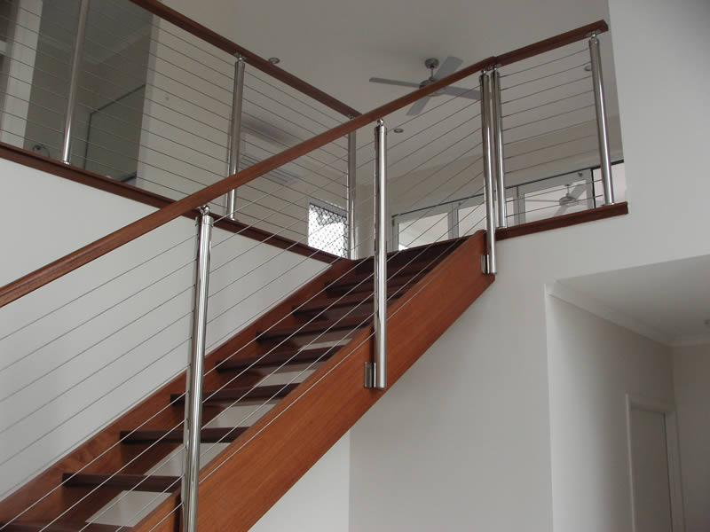 Stairs stainless steel posts and wire timber top rail
